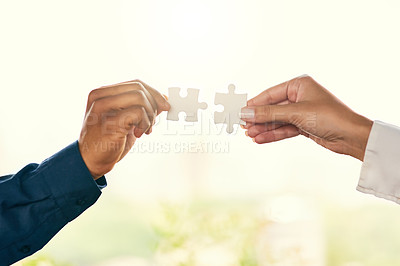 Buy stock photo Closeup shot of two unrecognizable businesspeople people joining puzzle pieces together