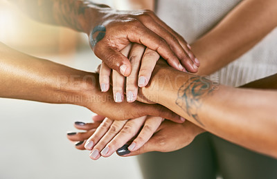 Buy stock photo Closeup shot of a group of people joining their hands in a huddle