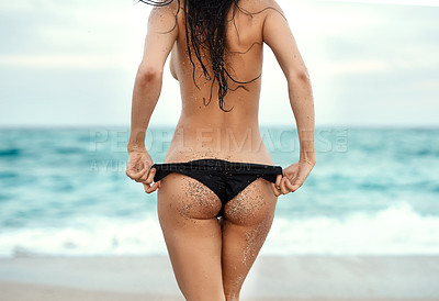 Buy stock photo Rearview shot of an unrecognizable woman in her bikini at the beach