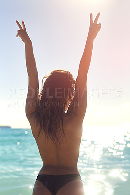 Buy stock photo Rearview shot of an unrecognizable woman on the beach