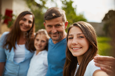 Buy stock photo Cropped portrait of a young family of four standing outside