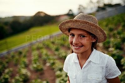 Buy stock photo Cropped portrait of a little girl standing outside on her family-owned farm