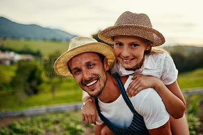 Buy stock photo Cropped portrait of a handsome man piggybacking his young daughter while working on their farm
