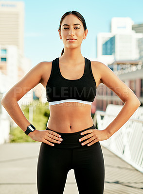 Buy stock photo Portrait of a sporty young woman exercising in the city