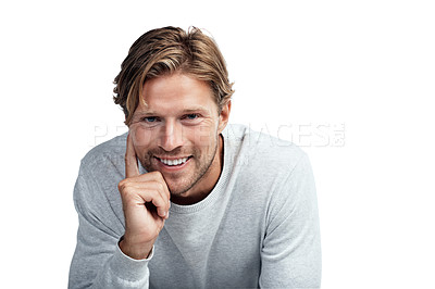 Buy stock photo Studio portrait of a handsome young man sitting against a white background