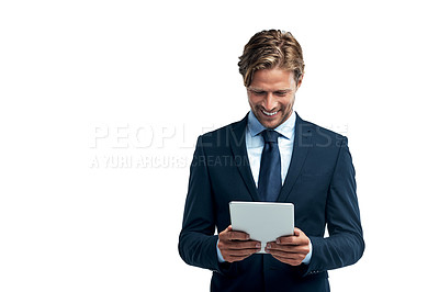 Buy stock photo Studio shot of a handsome young businessman using a digital tablet isolated on white