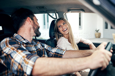 Buy stock photo Shot of a young couple travelling in a car together