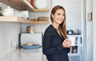 Buy stock photo Shot of an attractive young woman relaxing with a cup of coffee at home