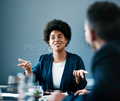 Buy stock photo Cropped shot of an attractive young businesswoman talking to her colleagues during a meeting in the boardroom