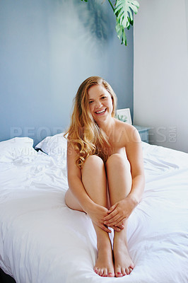 Buy stock photo Full length portrait of an attractive young woman sitting on her bed while in her pyjamas