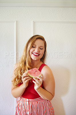 Buy stock photo Cropped shot of a beautiful young woman against a white wall indoors