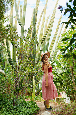 Buy stock photo Cropped shot of a beautiful young woman in the backyard at home
