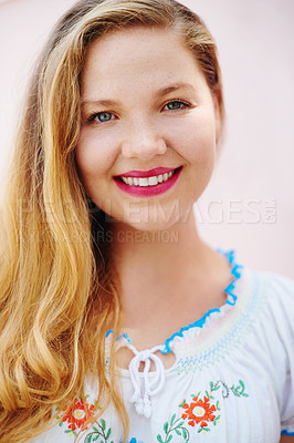 Buy stock photo Portrait of a beautiful young woman posing against a pink wall outside