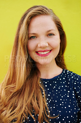 Buy stock photo Portrait of a beautiful young woman posing against a bright yellow wall outside