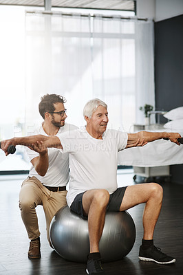 Buy stock photo Shot of a physiotherapist working with a senior patient