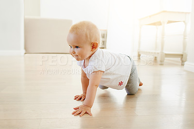 Buy stock photo Shot of an adorable baby girl learning to crawl at home