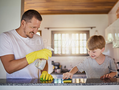Buy stock photo Shot of a father and his little son doing chores together at home