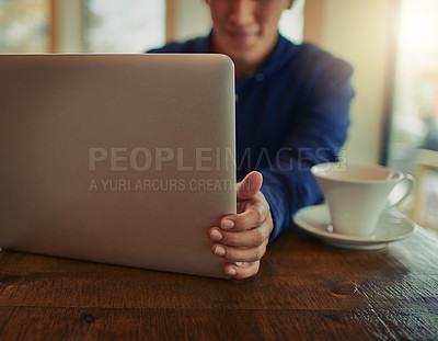 Buy stock photo Cropped shot of a man using a laptop in a cafe
