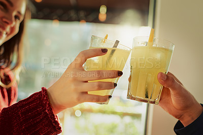 Buy stock photo Cropped shot of a young couple toasting with their drinks at a coffee shop