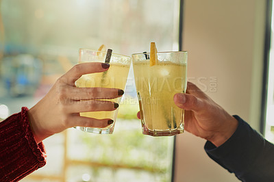 Buy stock photo Cropped shot of a couple toasting with their drinks at a coffee shop