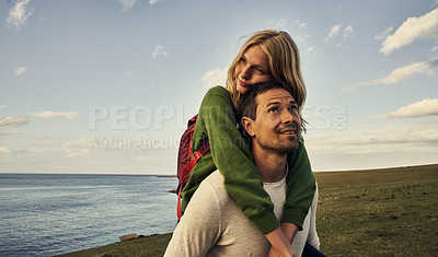 Buy stock photo Cropped shot of an attractive young couple spending the day in nature