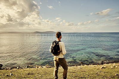 Buy stock photo Rearview shot of an unrecognizable man exploring nature
