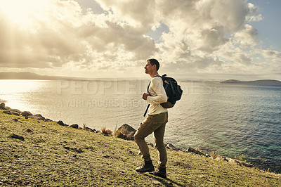 Buy stock photo Shot of a handsome young man exploring nature