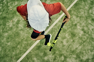 Buy stock photo High angle shot of a young boy messing around while playing tennis