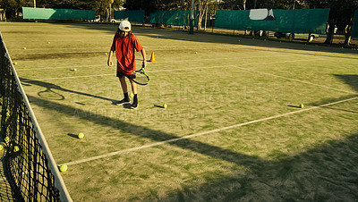Buy stock photo High angle shot of a young boy playing tennis
