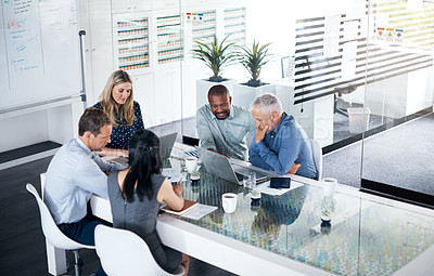 Buy stock photo Shot of a group of businesspeople having a meeting in the boardroom of a modern office