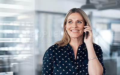 Buy stock photo Shot of a mature businesswoman using a mobile phone in a modern office
