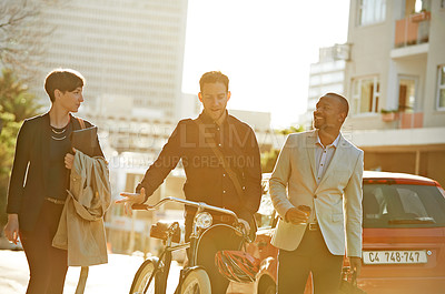 Buy stock photo Cropped shot of three businesspeople on their way to work