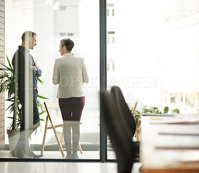 Buy stock photo Full length shot of two businesspeople meeting on the balcony of their office