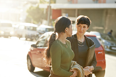 Buy stock photo Cropped shot of two attractive young businesswomen on their way to work