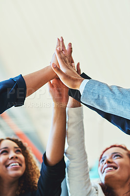 Buy stock photo Shot of a group of businesspeople high fiving together in an office