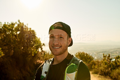 Buy stock photo Cropped portrait of a handsome young man enjoying an early morning hike in the mountains