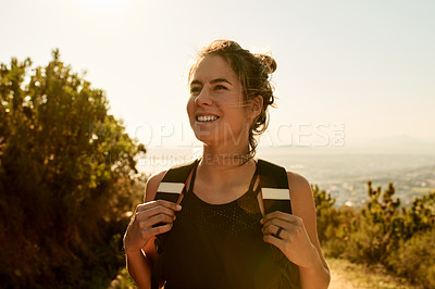 Buy stock photo Cropped shot of an attractive young woman enjoying an early morning hike in the mountains