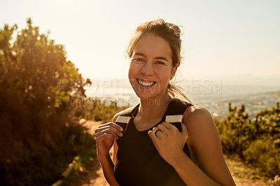 Buy stock photo Cropped portrait of an attractive young woman enjoying an early morning hike in the mountains