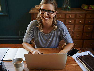 Buy stock photo High angle shot of a beautiful young woman working from home