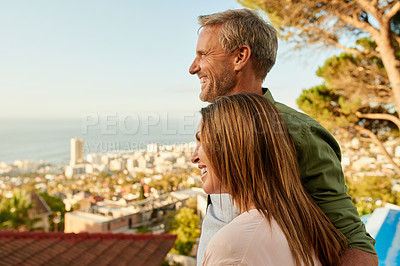 Buy stock photo Cropped shot of an affectionate mature couple taking in the sights outdoors