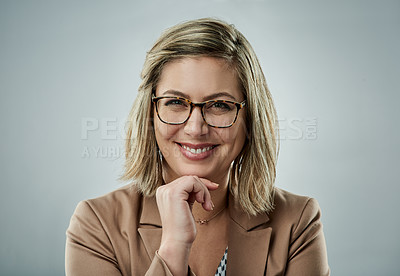 Buy stock photo Studio portrait of a happy young businesswoman against a gray background