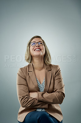 Buy stock photo Studio shot of a happy young businesswoman against a gray background