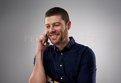Buy stock photo Studio shot of a handsome young man on a call against a grey background
