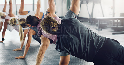 Buy stock photo Shot of a group of young people lined up and doing t push ups in a gym