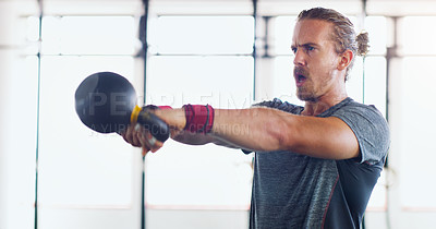 Buy stock photo Shot of a young person working out in a gym
