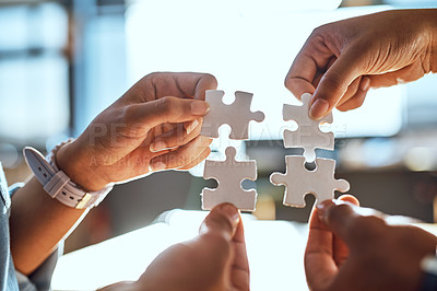 Buy stock photo Closeup shot of an unrecognizable group of people joining puzzle pieces together