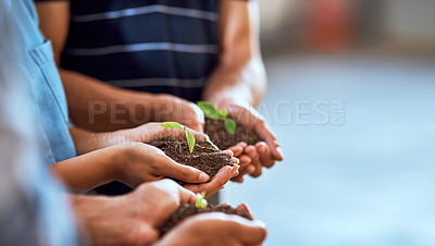 Buy stock photo Closeup shot of a group of people holding plants growing in soil