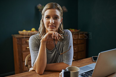 Buy stock photo Cropped shot of a beautiful young woman working from home