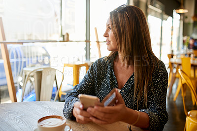 Buy stock photo Shot of a mature woman looking thoughtful while sitting in a coffee shop