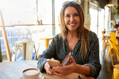 Buy stock photo Shot of a happy mature woman having coffee at a cafe